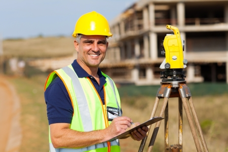 land surveyor: happy senior land surveyor at work Stock Photo