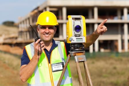 tacheometer: land surveyor speaking on walkie talkie Stock Photo