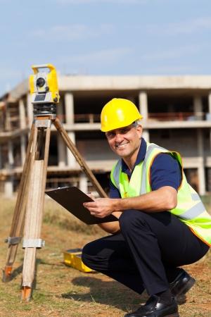 land surveyor: senior land surveyor at work