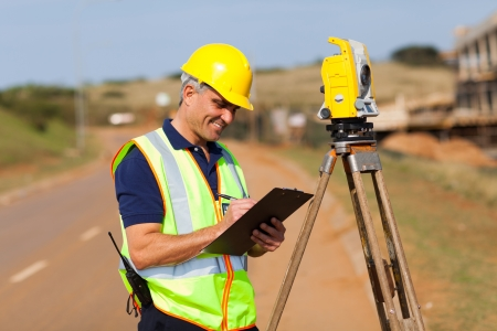 senior surveyor working on the road