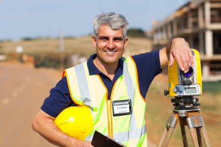 tacheometer: middle aged land surveyor portrait outdoors