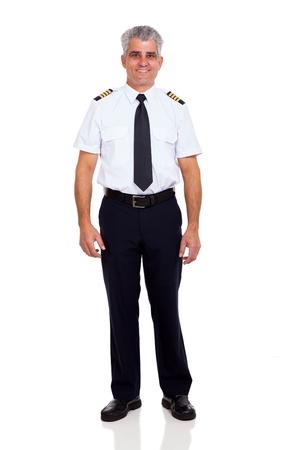 pilot: smiling senior airline pilot standing on white background