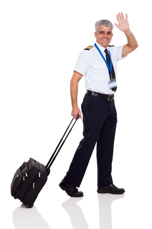 mid age airline pilot waving goodbye on white background photo