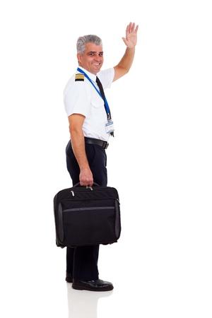 cheerful senior captain waving goodbye isolated on white photo