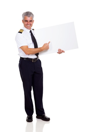 happy senior airline captain pointing empty board isolated on white photo