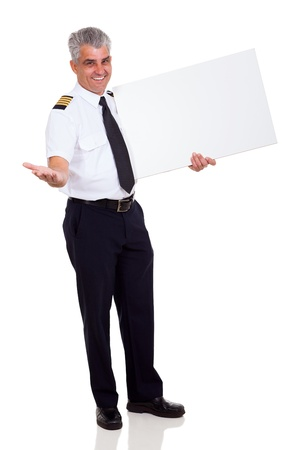 captain: cheerful airline pilot advertising with blank banner