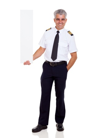 middle aged airline pilot captain holding vertical blank banner on white background photo