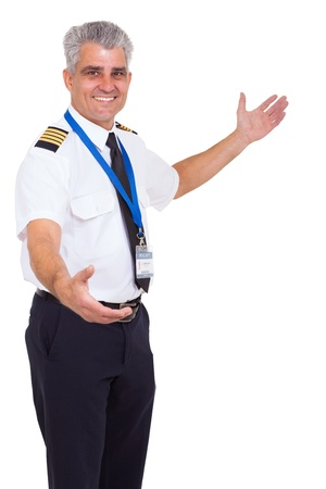 airline pilot: handsome senior airline pilot welcome gesture on white background