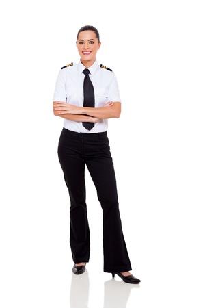 mooie vrouwelijke jonge airline co-piloot met de armen gekruist geïsoleerd op wit Stockfoto