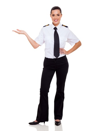attractive female airline pilot presenting on white photo