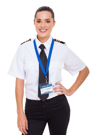 beautiful young female airline co-pilot isolated on white Imagens