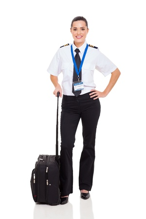 beautiful woman airline pilot with briefcase standing on white background photo