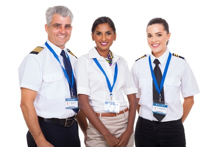 beautiful airline crew standing on white background photo