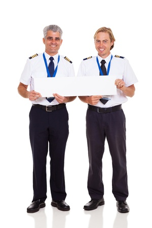 smiling airline pilots holding blank banner on white background photo