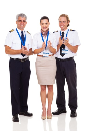 group of happy airline crew applauding isolated on white photo