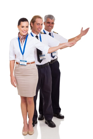 group of airline crew presenting standing on white background
