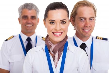 flight attendant: beautiful flight attendant standing in front of two pilots