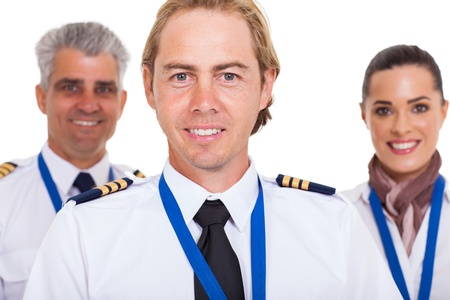 smiling first officer with airline crew over white background photo