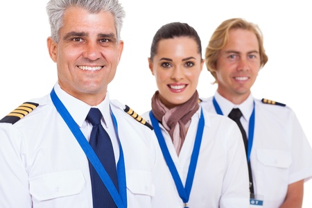 epaulettes: smiling middle aged pilot and crew isolated on white