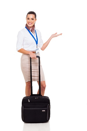flight attendant: attractive young flight attendant with welcome hand sign