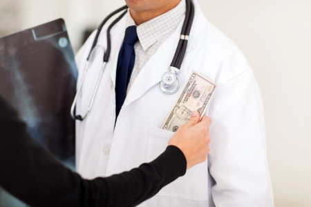 pharmaceutical sales rep bribing doctor, putting money in his pocket photo