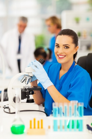 pretty medical lab technician working in lab photo