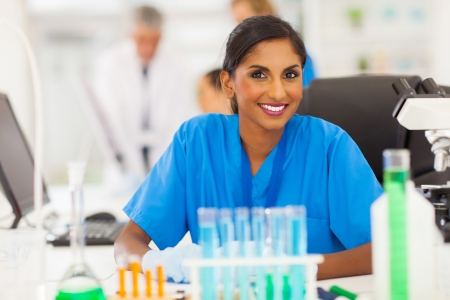beautiful young indian researcher working in lab photo