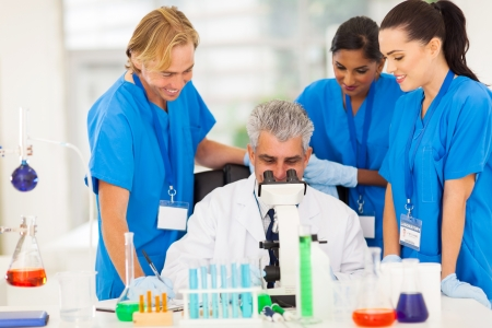 group of scientists working in lab Stock Photo - 21122910