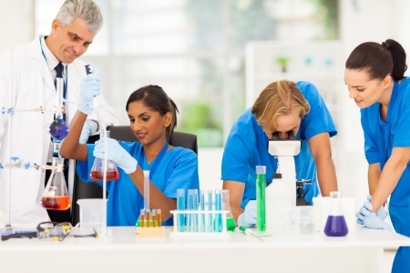 group of medical researchers working in lab photo