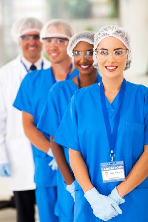 smiling medical researchers team in lab photo