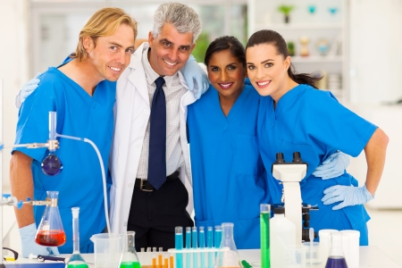 group of smiling scientists team in laboratory photo