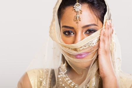 portrait of beautiful indian woman in sari costume covering her face Stock Photo - 21123006