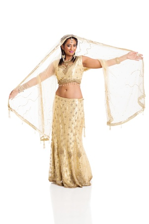 happy young indian woman in sari dancing on white background photo