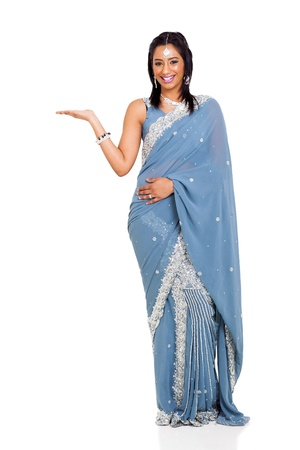 cheerful indian woman wearing sari presenting isolated on white photo