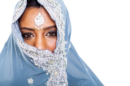 traditional Indian woman in sari covering her face with veil photo