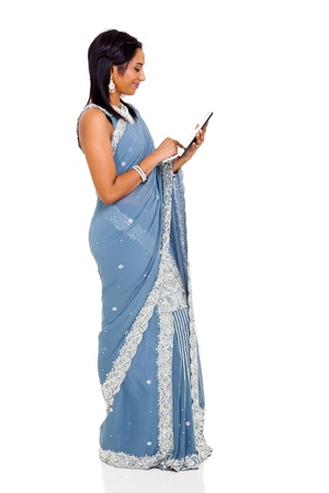traditional indian woman in sari using tablet computer photo