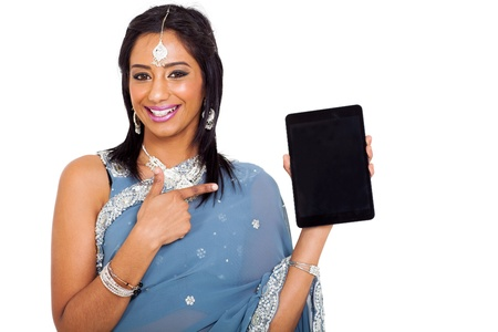 cute young indian woman in sari pointing tablet computer on white background photo
