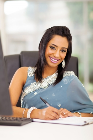 attractive indian white collar worker in modern office photo
