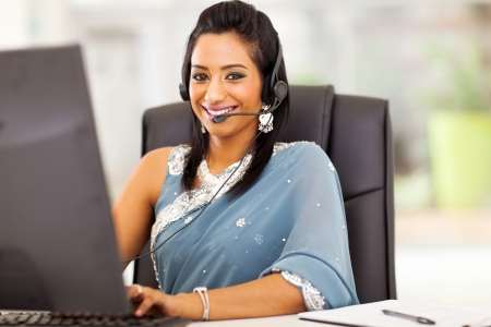 close up of beautiful indian business customer service operator in office photo