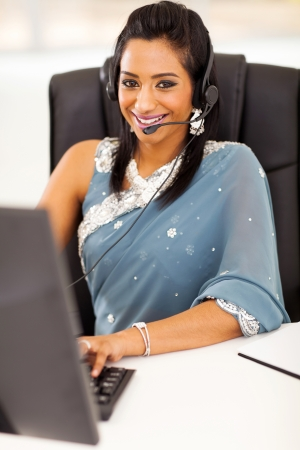 pretty happy young indian call center employee with headset Stock Photo - 21123040