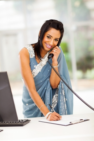 indian saree: happy modern indian secretary taking message in office