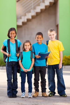 group of elementary school students standing outdoors photo