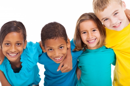 happy children: group of multiracial kids portrait in studio on white background