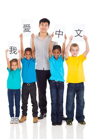 i kids: group of primary pupils learning chinese with teacher Stock Photo