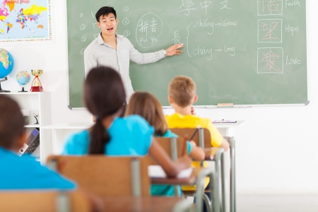teaching adult: elementary school teacher teaching chinese language in classroom Stock Photo