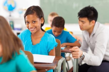 beautiful african american school girl in classroom  photo