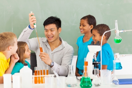 primary school science teacher demonstrating science experiment Stock Photo