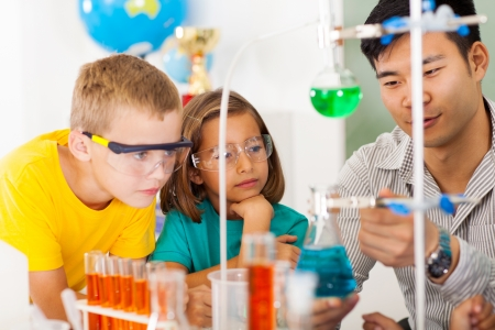 primary students in science class with teacher photo