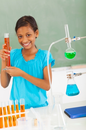science class: happy female elementary school pupil in science class Stock Photo