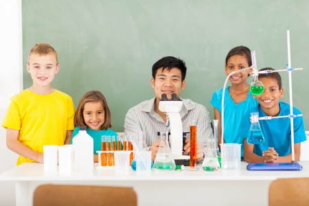 science class: group elementary school students and teacher in a science class  Stock Photo